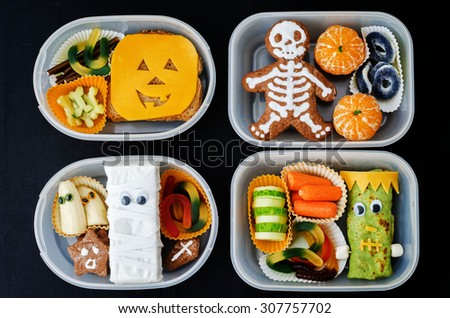 lunch boxes for children in the form of monsters for Halloween. the toning. selective focus - stock photo