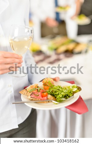 Lunch buffet at business meeting woman hold catering food plate - stock photo