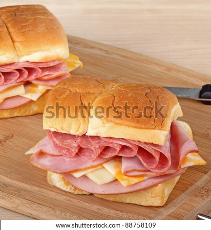 Lunch meat sandwiches on a cutting board - stock photo