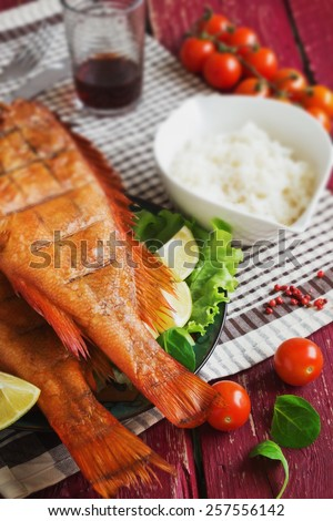 lunch of smoked sea bass on wooden background. food of the useful seafood. health and diet food
