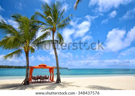 Lunch time on tropical sandy beach in Mauritius Island - stock photo