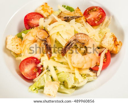 Lunch with shrimps, cheese, salad and tomato