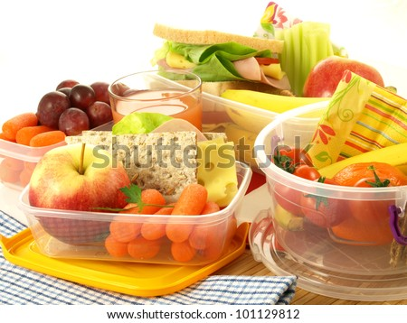 Lunch with various fruits and vegetables in boxes