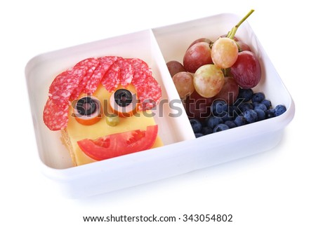 Lunchbox with creative sandwich and fruits isolated on white background - stock photo
