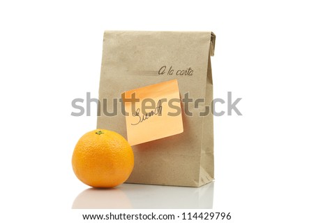 Lunchpack With Orange Isolated On White - stock photo