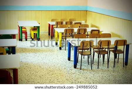 lunchroom of the refectory of the kindergarten with desks and colored chairs