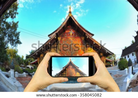 Lung Phra Bang, Laos. Taking photo on smart phone concept.    - stock photo