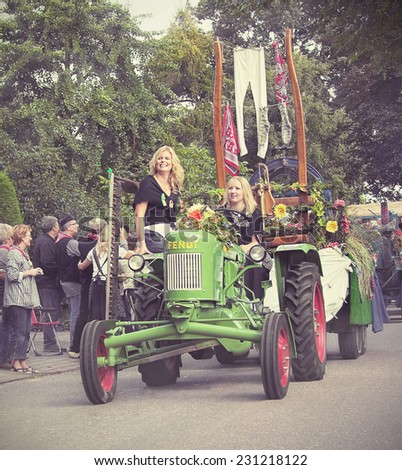 LUNTEREN, THE NETHERLANDS - AUG 29, 2009: Dutch farmers celebrate the end of Heideweek with a historic parade. Filtered textured image in a retro nostalgic style.  - stock photo