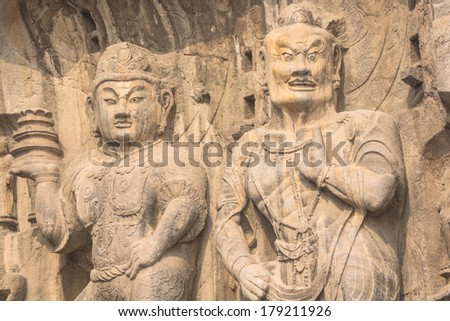 LUOYANG,CHINA - OCTOBER  22,2013 : The Longmen Grottoes with Buddha's figures are located on both banks of the Yi River, near Luoyang City, Henan province, China. Protected by UNESCO.