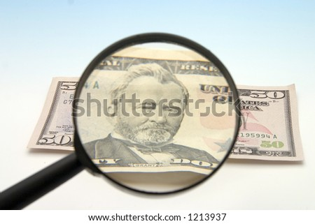 Lupe on dollar - stock photo