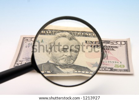 lupe zooming cash - stock photo