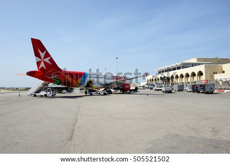 LUQA, MALTA - APRIL 18: The aircraft of Malta Airlines taking maintenance at Malta Airport on April 18, 2015 in Luqa, Malta. More then 1,6 mln tourists is expected to visit Malta in year 2015.