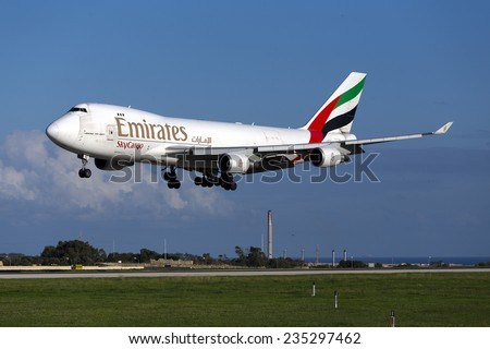 Luqa, Malta December 4, 2014: Emirates SkyCargo (TNT) Boeing 747-4HAF/ER/SCD landing down runway 31. - stock photo
