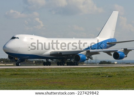 Luqa, Malta February 12, 2012: Boeing 747-2B4BM(SF) lining up for takeoff. - stock photo