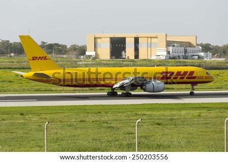Luqa, Malta February 5, 2015: DHL (European Air Transport - EAT) Boeing 757-236(SF) landing runway 31 on its daily cargo flight to Malta. - stock photo