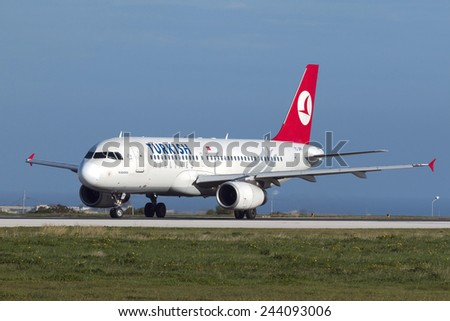 Luqa, Malta January 14, 2015: Turkish Airlines Airbus A320-232 awaits take off clearance on runway 31. - stock photo