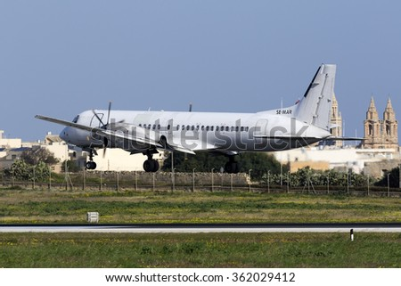 Luqa, Malta January 12, 2016: West Air Europe Cargo British Aerospace ATP(F) [SE-MAR] in all white livery landing runway 31. - stock photo