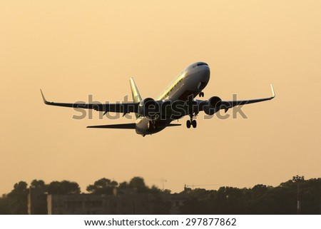 Luqa, Malta July 16, 2015: Transavia Airlines Boeing 737-8K2 departing runway 13 in the sunset.