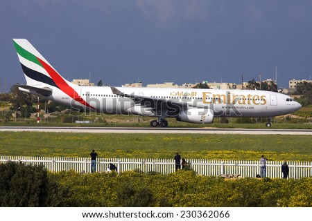 Luqa, Malta March 19, 2011: Emirates Airbus A330-243 getting some photos taken by spotter who were actually waiting for the Lufthansa A380 to arrive. - stock photo
