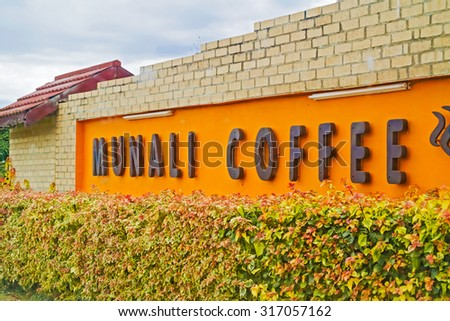 Lusaka, Zambia - April 4, 2015: Sign at the entrance to Munali coffee farm near Lusaka in Zambia. - stock photo