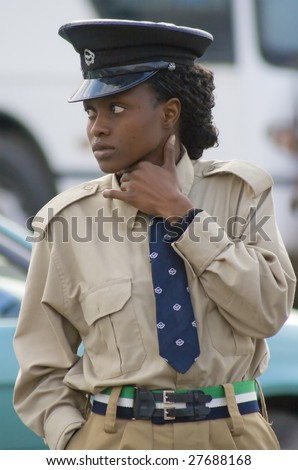 LUSAKA , ZAMBIA - AUGUST 4. : Local police woman on patrol at central bus station August 4, 2008 in Lusaka, Zambia. Lusaka is located about 1,300m above sea level. - stock photo