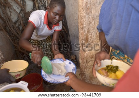 LUSAKA,ZAMBIA–DECEMBER 3:A cook distributed the food to workers in the potato field, offer them food every day to 300 workers, on December 3,2011 in Lusaka,Zambia - stock photo