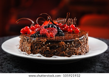 Luscious chocolate cake with fresh berries - stock photo