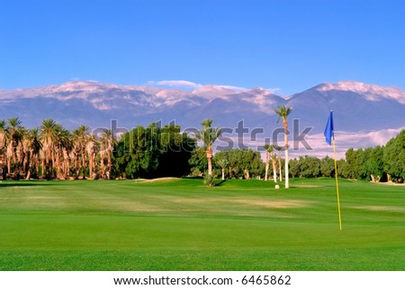lush golf course green and oasis in california desert - stock photo