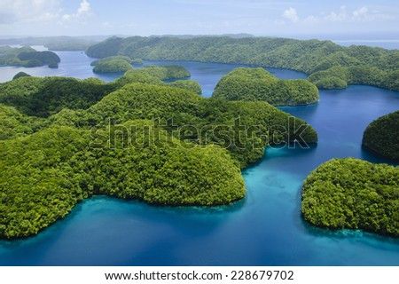 Lush green forested rock islands of the Republic of Palau with blue Pacific Ocean - stock photo