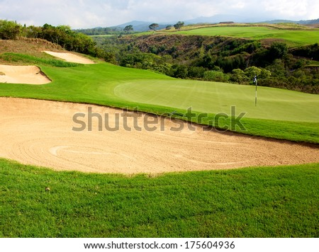 Lush green golf course in Maui Hawaii - stock photo