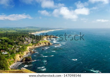 Lush green Oregon coast with beautiful blue Pacific Ocean - stock photo