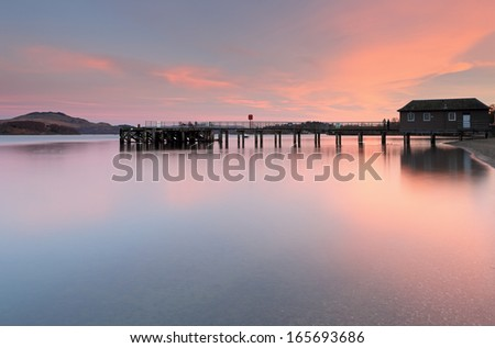 Luss pier at Sunset from the shores of Loch Lomond, Scotland.
