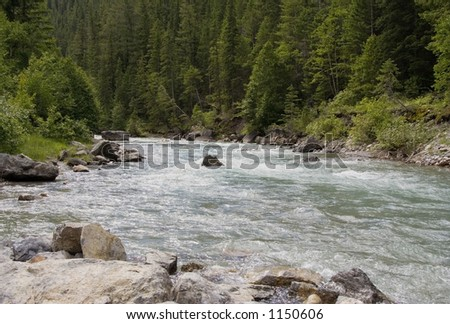 Lussier River in the Rocky Mountains - Creek with frigid water and strong current alongside hot pools - stock photo