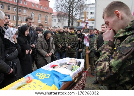 LUTSK, UKRAINE - February 23, 2014: memorial service at Cathedral on 21 year old Euromaidan activist Vasyl Moysey who was killed in Kiev clashes with riot police on Hrushevskoho st
