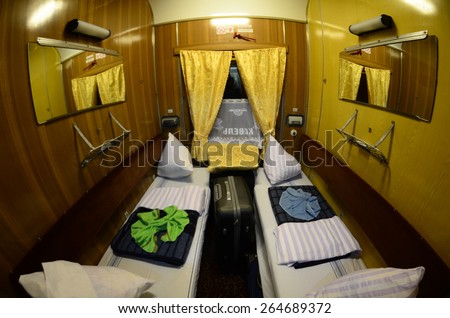 LUTSK, UKRAINE - SEPTEMBER 24: interior of a First Class cabin on the Kovel-Kyiv sleeper train on September 24, 2014. Ukraine has a combined total length of rail track of over 23,000 km. - stock photo