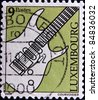 LUXEMBOURG  - CIRCA 2000: A stamp printed in Luxembourg shows an electric guitar, circa 2000 - stock photo