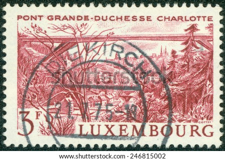LUXEMBOURG - CIRCA 1966: A stamp printed in Luxembourg, shows Grand Duchess Charlotte Bridge with the same inscription and name of series, circa 1966 - stock photo