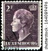"LUXEMBOURG - CIRCA 1948: A stamp printed in Luxembourg shows  Grand Duchess of Luxembourg Charlotte, without inscription, from the series ""Grand Duchess of Luxembourg Charlotte"", circa 1948  - stock photo"