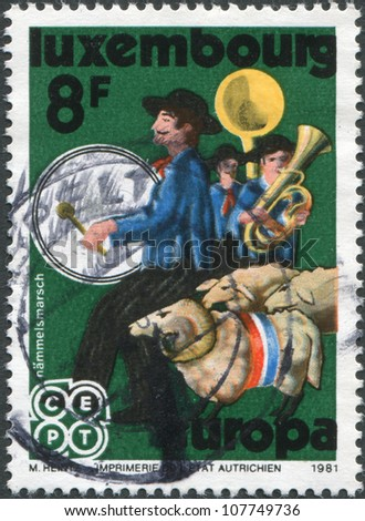 LUXEMBOURG - CIRCA 1981: A stamp printed in Luxembourg, shows Hammelsmarsch (Sheep Procession), circa 1981 - stock photo