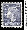 "LUXEMBOURG - CIRCA 1948: A stamp printed in Luxembourg shows portrait of Grand Duchess of Luxembourg Charlotte, without inscription, from the series ""Grand Duchess of Luxembourg Charlotte"", circa 1948 - stock photo"