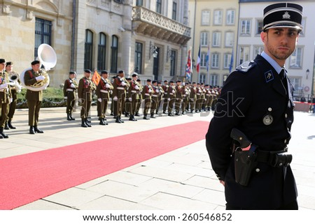 LUXEMBOURG, LUXEMBOURG - MARCH 9, 2015: Military band and officer during official visit of Francois Hollande, president of France, to Luxembourg.