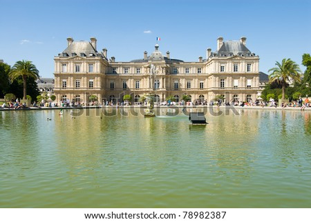 Luxembourg Palace and octagonal basin. The Jardin du Luxembourg is the second largest public park in Paris, France. The park is the garden of the French Senate. - stock photo