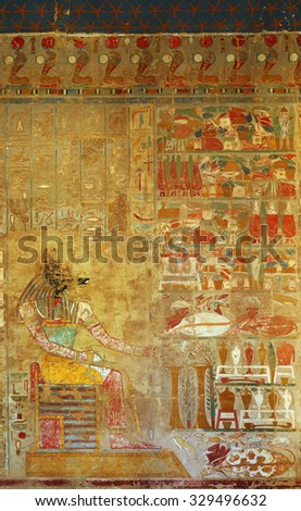 LUXOR, EGYPT - DECEMBER 05, 2014: ancient egypt color image of anubis on wall