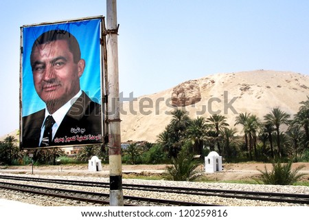 LUXOR - MAY 01:Poster of the former Egyptian President Mohammed Hosni Mubarak on on May 01  2007 in Luxor, Egypt. Mubarak was ousted after 18 days of demonstrations during the 2011 Egyptian revolution - stock photo