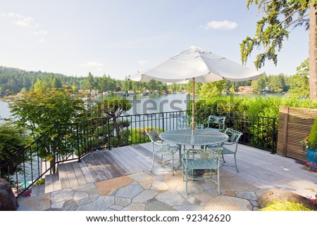 Luxurious and Private Backyard Patio on Sunny Day - stock photo