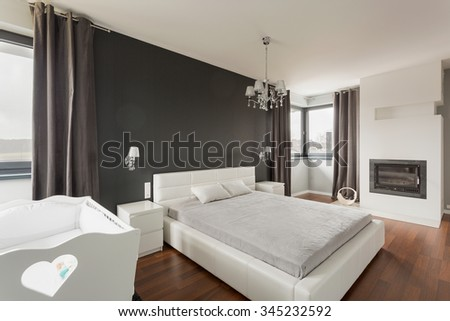 Luxurious and spacious master bedroom in modern residence - stock photo