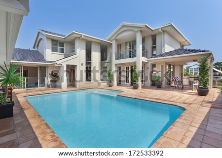 luxurious backyard with pool in modern australian mansion - stock photo