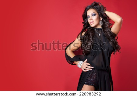 luxurious beautiful brunette woman in evening dress - stock photo