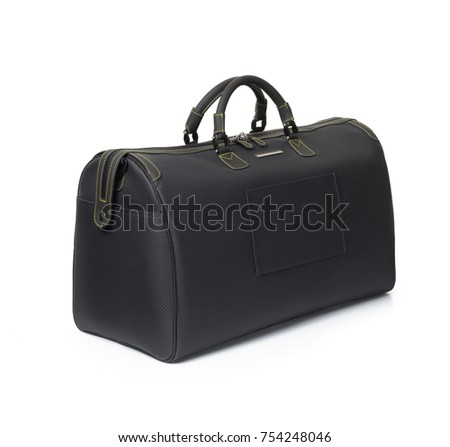 Luxurious, beautiful large, black travel bag made of carbon and leather, on white background