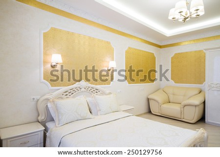 Luxurious bed with cushion in royal bedroom interior. Hotel room - stock photo